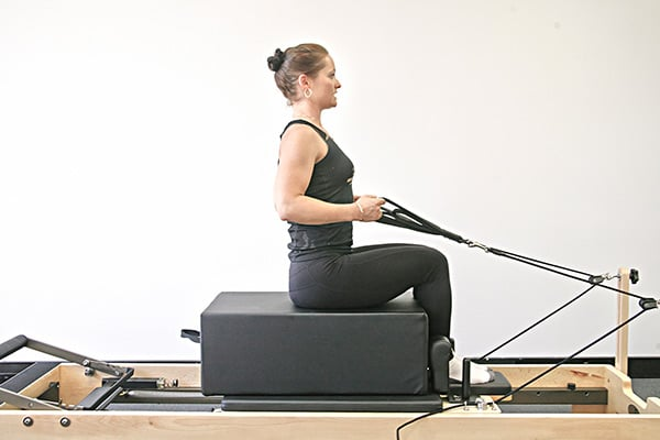reformer exercise arms in straps