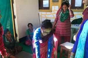 Nepal - Woman squatting